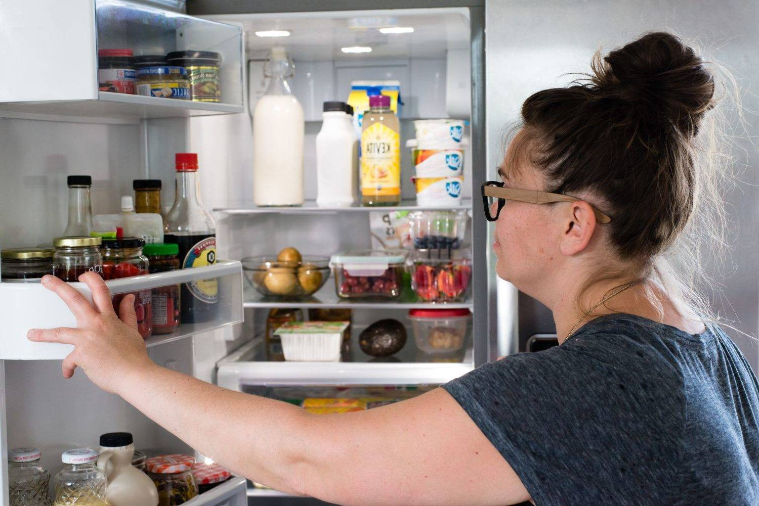 Rose checking what's in her refrigerator.
