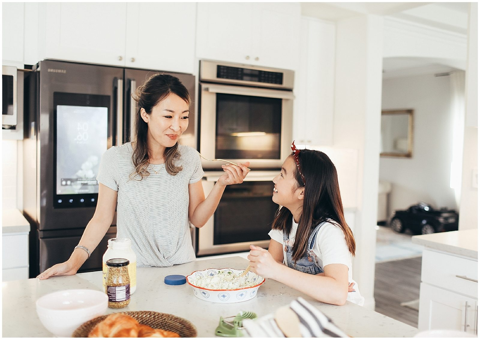 Mom and her daughter tasting the food.