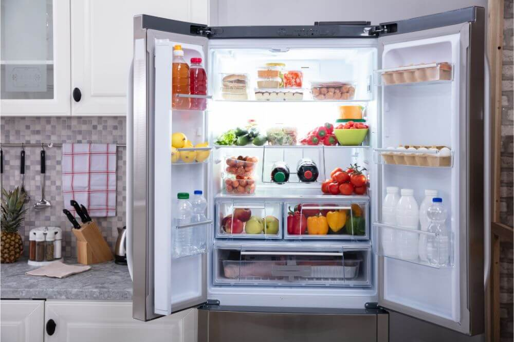 Open Refrigerator Filled With Fresh Fruits And Vegetables