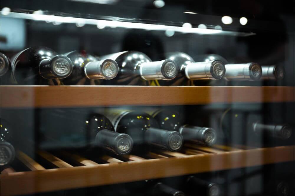 wine bottles in wine fridge