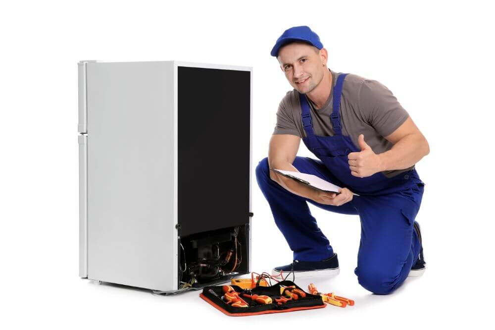Repairman and mini fridge